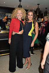 Left to right, KELLY HOPPEN and NATASHA CORRETT at a party to celebrate the publication of Honestly Healthy Cleanse by Natasha Corrett held at Tredwell's Restaurant, 4a Upper St.Martin's Lane, London on 14th January 2015.
