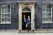 March 18, 2020, London, England, United Kingdom: Britain's Chief Medical Officer Chris Whitty (L) and Britain's Chief Executive of NHS England Simon Stevens (R) leaves Downing Street, London, after a meeting on Wednesday, March 18, 2020. .For most people, the new coronavirus causes only mild or moderate symptoms, such as fever and cough. For some, especially older adults and people with existing health problems, it can cause more severe illness, including pneumonia. (Credit Image: © Vedat Xhymshiti/ZUMA Wire)