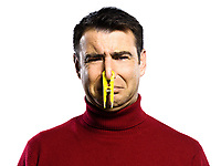 caucasian man unpleasant smell studio portrait on isolated white backgound