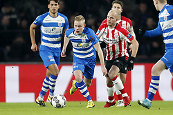 (L-R) Rick Dekker of PEC Zwolle, Jorrit Hendrix of PSV during the Dutch Eredivisie match between PSV Eindhoven and PEC Zwolle at the Phillips stadium on February 03, 2018 in Eindhoven, The Netherlands