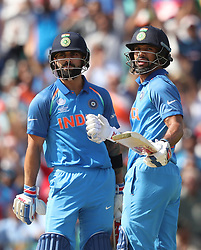 India's Shikhar Drawn (right) and Virat Kohl (left) during the ICC Champions Trophy, Group B match at The Oval, London.