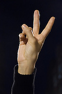 """The hand of a girl making the """"V"""" victory sign in protest for the disapearance of 43 students in Iguala, Guerrero."""