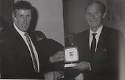 "Tipperary Chairman in 1989 Noel Morris makes a presentation to Johnny Ryan, Moycarkey, caption of the 1941 Munster Champion (Lovingly referred to the foot and mouth All-Ireland champions in Tipperary). Johnny won an All-Ireland medal in 1937 along with his brother ""Sweeper"". ""Sweeper"" and another brother ""Mutt"" won medals in 1945."