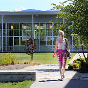 Mt. McLoughlin peeks over the school. Teachers at South Medford High School use a proficiency-based system.