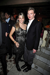 SARAH-JANE BOLER and HENRY CONWAY at a party to celebrate the launch of Atelier-Mayer.com held at 83 Princedale Road, London W11 on 15th January 2009.