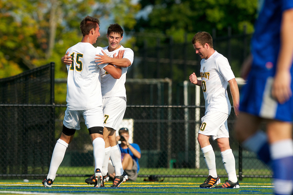 Catamounts defenseman Salvatore Borea (15) and Catamounts midfielder Jonny Bonner (20) celebrate Catamounts forward Jesse Scheirer's (7) goal during the men's soccer game between the Central Connecticut State University Blue Devils and the Vermont Catamounts at Virtue Field on Friday afternoon September 7, 2012 in Burlington, Vermont.