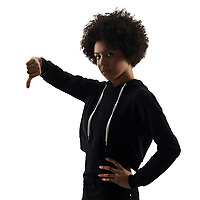 one mixed race african young teenager girl woman Thumbs Down in studio shadow silhouette isolated on white background