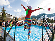 NEWS&GUIDE PHOTO / PRICE CHAMBERS<br /> Morgane Boag leaps into the frigid pool outside the Teton County Recreation Center on Saturday during the Jackalope Jump. The event raises money for Special Olympics Wyoming.