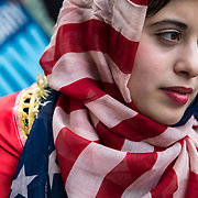 Immigrants rights advocates protest President Donald Trump and his anti-immigrant policies which include ICE raids and proposed bans on Muslim immigrants entering the country. Photographed for Contact Press Images.