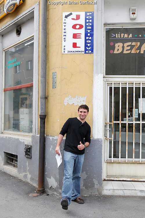 Joel in front of a sign on the street in Zilina, Slovakia on Saturday July 2nd 2011. (Photo by Brian Garfinkel)