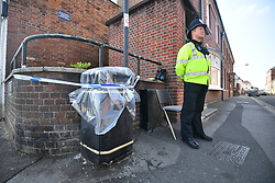 © Licensed to London News Pictures. 05/07/2018. Salisbury, UK. A Police officer guards a taped up bin near John Baker House in Salisbury, Wiltshire an area visited by two people who are in critical condition after being exposed to the Novichok nerve agent. Dawn Sturgess, 44, and Charlie Rowley, 45 hav been confirmed as having come in to contact with the deadly agent after samples were sent to the MoD's Porton Down laboratory. Former Russian spy Sergei Skripal and his daughter Yulia were poisoned with Novichok nerve agent in nearby Salisbury in March 2018 causing diplomatic tentions between Russia and the UK. Photo credit: Ben Cawthra/LNP