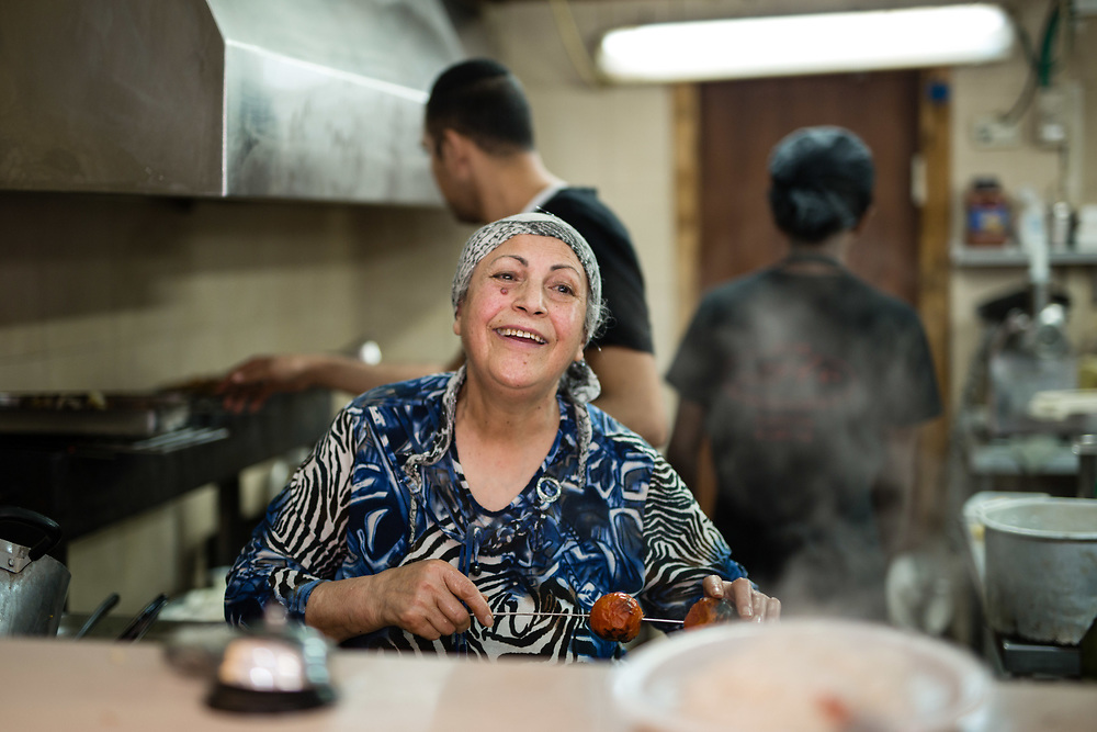 Molouk Hanassab, an Iranian-born Israeli is seen as she prepares food at her family owned  Persian style restaurant, Shamshiri, in the Levinsky Market in southern Tel Aviv, Israel, on April 16, 2015. The majority of the Levinsky Market vendors are traditional Iranian Jews, many of whom fled the Islamic Republic after Ayatollah Khomeini rose to power in 1979.