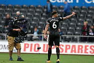 goalscorer Jamaal Lascelles of Newcastle Utd celebrates at the final whistle . Premier league match, Swansea city v Newcastle Utd at the Liberty Stadium in Swansea, South Wales on Sunday 10th September 2017.<br /> pic by  Andrew Orchard, Andrew Orchard sports photography.