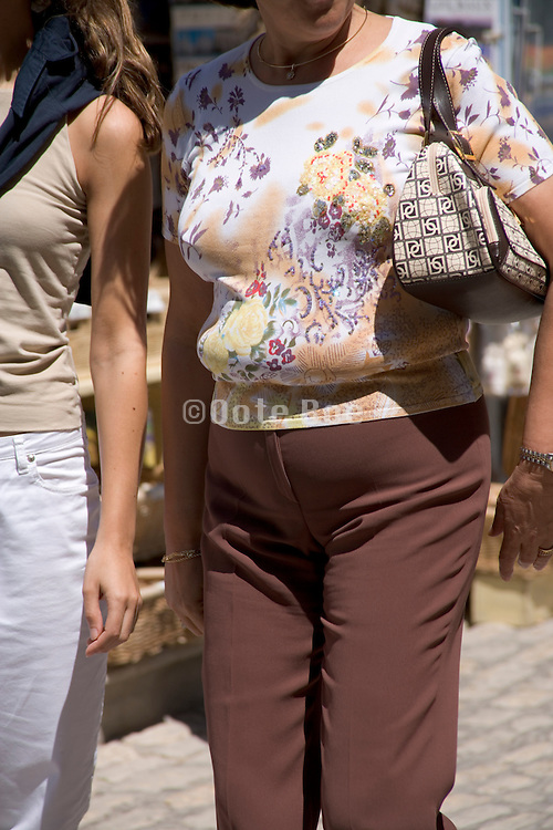 a middle aged woman with a fatty belly