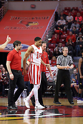 17 February 2018:  Trainer John Munn helps William Tinsley off the court after a hard fall during a College mens basketball game between the University of Northern Iowa Panthers and Illinois State Redbirds in Redbird Arena, Normal IL