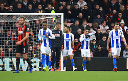 Bournemouth goalkeeper Artur Boruc (second left) and Brighton & Hove Albion's Florin Andone exchange words after the second goal during the Emirates FA Cup, third round match at the Vitality Stadium, Bournemouth.