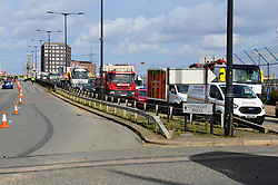 © Licensed to London News Pictures. 10/10/2019. London UK: Traffic builds up as Extinction Rebellion protesters block the access road to London City airport. Police are stopping protesters from shutting down the airport as their campaign enters its forth day , Photo credit: Steve Poston/LNP