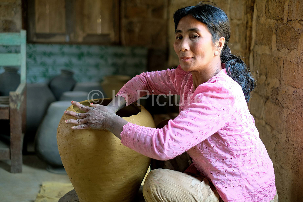 Hand making a clay pot in Kyauk Daing pottery village on the banks of Inle Lake on 21st January 2016 in Shan State, Myanmar