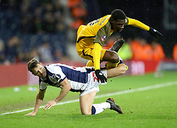"""West Bromwich Albion's Wes Hoolahan (left) and Brighton & Hove Albion's Yves Bissouma battle for the ball during the FA Cup fourth round replay match at The Hawthorns, West Bromwich. PRESS ASSOCIATION Photo. Picture date: Tuesday February 5, 2019. See PA story SOCCER West Brom. Photo credit should read: Aaron Chown/PA Wire. RESTRICTIONS: EDITORIAL USE ONLY No use with unauthorised audio, video, data, fixture lists, club/league logos or """"live"""" services. Online in-match use limited to 120 images, no video emulation. No use in betting, games or single club/league/player publications."""