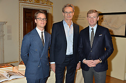 LONDON, ENGLAND 28 NOVEMBER 2016:  Left to right, Wolf Burchard, Paul Holberton and Nicolas Cattelain at a reception to celebrate the publication of The Sovereign Artist by Christopher Le Brun and Wolf Burchard held at the Royal Academy of Art, Piccadilly, London, England. 28 November 2016.