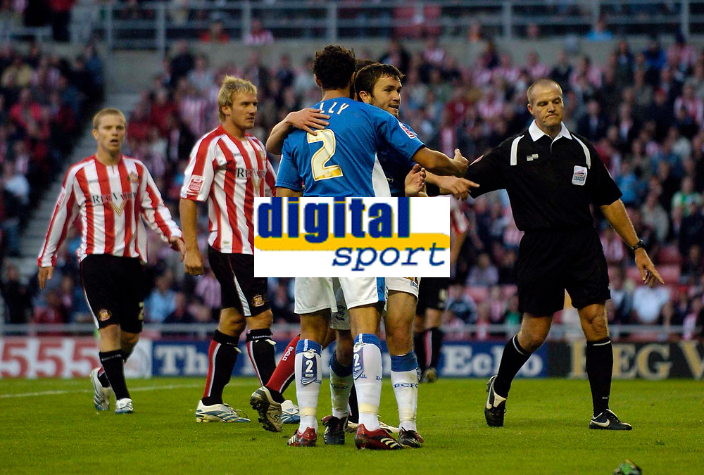 Photo: Jed Wee.<br /> Sunderland v Birmingham City. Coca Cola Championship. 09/08/2006.<br /> <br /> Birmingham's Stephen Kelly celebrates with Damien Johnson after Johnson earns a penalty.