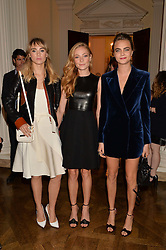 Left to right, SUKI WATERHOUSE, CLARA PAGET and CARA DELEVINGNE at a party hosed by the US Ambassador to the UK Matthew Barzun, his wife Brooke Barzun and editor of UK Vogue Alexandra Shulman in association with J Crew to celebrate London Fashion Week held at Winfield House, Regent's Park, London on 16th September 2014.