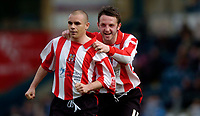 Photo: Richard Lane.<br />Wycombe Wanderers v Lincoln City. Coca Cola League 2. 17/04/2006. <br />Lincoln's Jamie Forrester celebrates his goal with Scott Kerr.