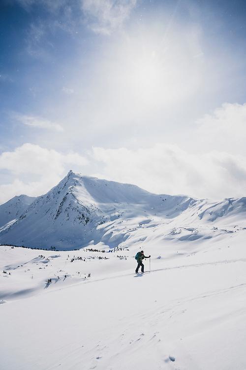 Matt Kennedyheads into the alpine above the Meadow Hut, Esplanade Range, BC.