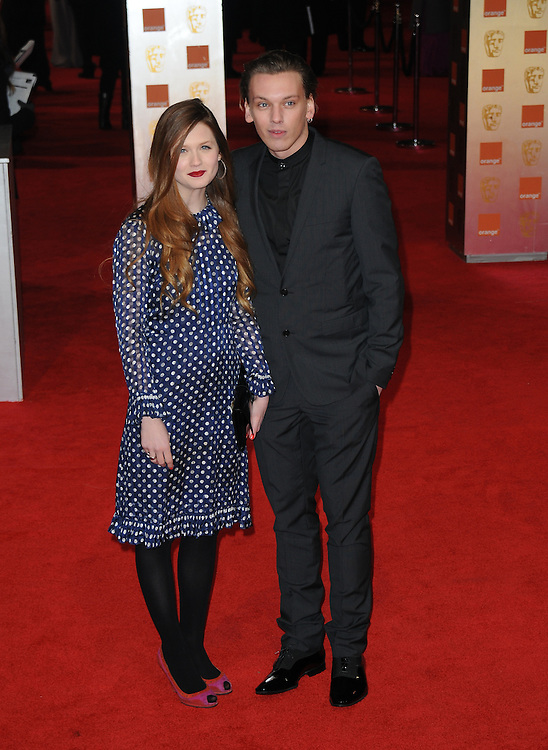 Bonnie Wright, Jamie Campbell Bower attends the Orange British Academy Film Awards 2012 at the Royal Opera House, London, UK.. 12/02/2012 Anne-Marie Michel/CatchlightMedia