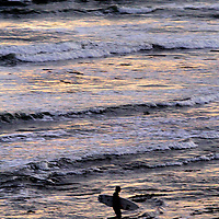The last light of day is reflected on the Monterey Bay as a surfer finishes a session off of Pleasure Point, just south of Santa Cruz, California.<br /> Photo by Shmuel Thaler <br /> shmuel_thaler@yahoo.com www.shmuelthaler.com