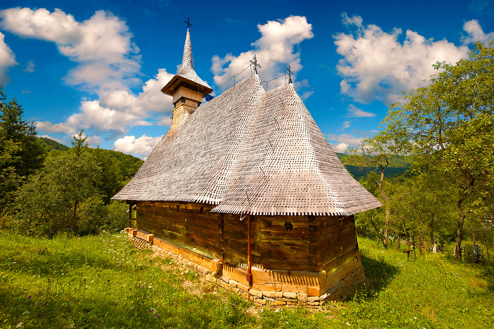 Maramures Wooden Church ( Biserica de Lemn ) of Cuvioasa Paraschiva, Northern Transylvania, Romania .<br /> <br /> Visit our ROMANIA HISTORIC PLACXES PHOTO COLLECTIONS for more photos to download or buy as wall art prints https://funkystock.photoshelter.com/gallery-collection/Pictures-Images-of-Romania-Photos-of-Romanian-Historic-Landmark-Sites/C00001TITiQwAdS8<br /> .<br /> Visit our MEDIEVAL PHOTO COLLECTIONS for more   photos  to download or buy as prints https://funkystock.photoshelter.com/gallery-collection/Medieval-Middle-Ages-Historic-Places-Arcaeological-Sites-Pictures-Images-of/C0000B5ZA54_WD0s