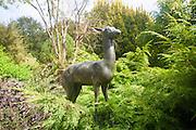 Bronze deer sculpture in Italianate garden of landscape gardener Harold Ainsworth Peto created between 1899 and 1933, at Iford Manor, near Freshford, Wiltshire, England, UK