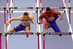 Great Britain's Andrew Pozzi (left) and Cuba's Roger Iribarne during Heat 2 of the Men's 60 Metres Hurdles during day four of the 2018 IAAF Indoor World Championships at The Arena Birmingham.