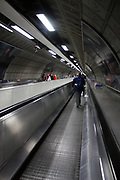 Escalator leading down into the London underground train system. 2012