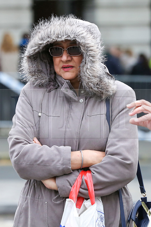 © Licensed to London News Pictures. 27/04/2019. London, UK. A woman wrapped in on a cold and windy day in London. Photo credit: Dinendra Haria/LNP