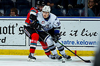 KELOWNA, BC - MARCH 11: Matthew Wedman #20 of the Kelowna Rockets back checks Kaid Oliver #34 of the Victoria Royals during second period at Prospera Place on March 11, 2020 in Kelowna, Canada. (Photo by Marissa Baecker/Shoot the Breeze)
