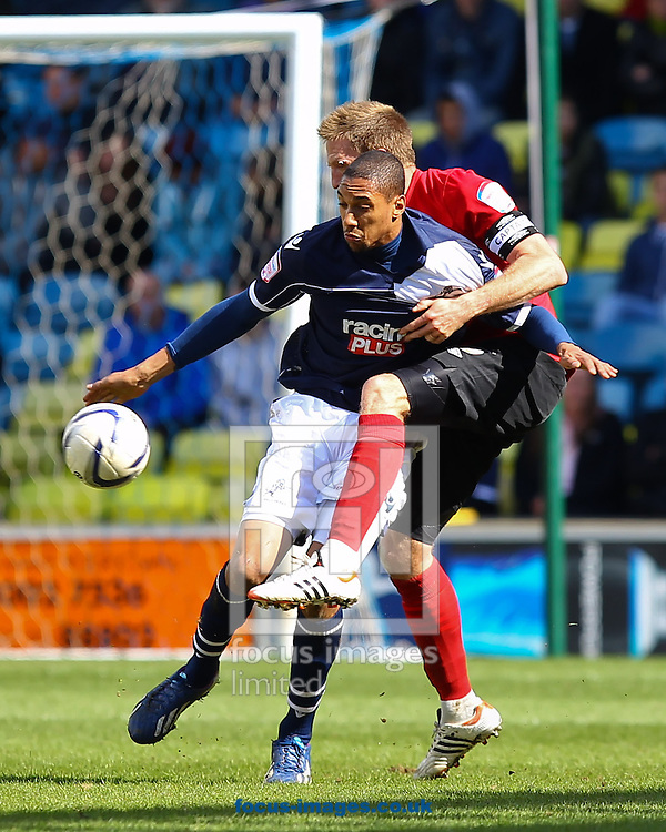 Picture by John Rainford/Focus Images Ltd +44 7506 538356.27/04/2013.Shaun Batt of Millwall and Danny Collins of Nottingham Forest during the npower Championship match at The Den, London.