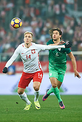 Wroclaw, Poland - 2016 November 14: (L) Lukasz Teodorczyk of Poland fights for the ball with (R) Rene Krhin of Slovenia during Poland v Slovenia - International Friendly Soccer Match at Municipal Stadium on November 14, 2016 in Wroclaw, Poland.<br /> <br /> Adam Nurkiewicz declares that he has no rights to the image of people at the photographs of his authorship.<br /> <br /> Picture also available in RAW (NEF) or TIFF format on special request.<br /> <br /> Any editorial, commercial or promotional use requires written permission from the author of image.<br /> <br /> Mandatory credit:<br /> Photo by © Adam Nurkiewicz / Mediasport