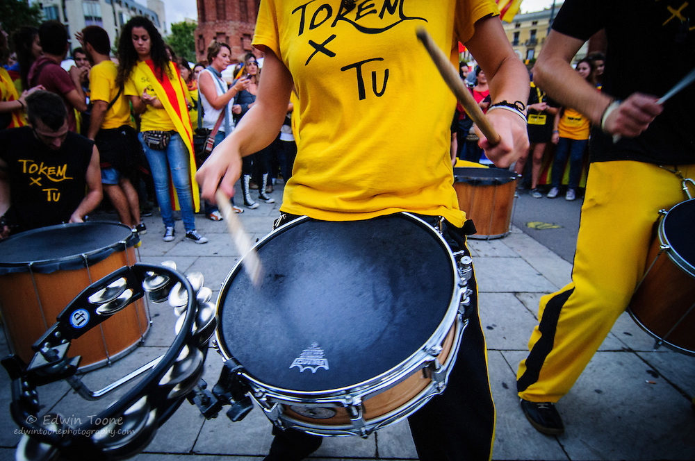 Drummers play and dance during the National Day of Catalonia.