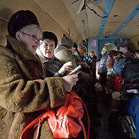 Passengers and their baggage crowd a Russian helicopter flying from Arkhangel'sk to remote arctic villages.