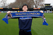 AFC Wimbledon fan holding scarf during the EFL Sky Bet League 1 match between AFC Wimbledon and Southend United at the Cherry Red Records Stadium, Kingston, England on 24 November 2018.