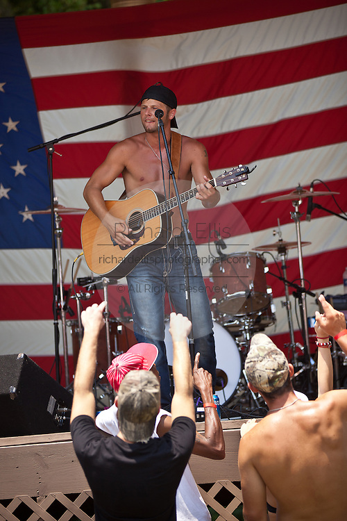 A southern rock band plays during the annual Summer Redneck Games Dublin, GA.