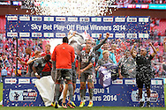 Rotherham United players celebrate  lifting the League One Playoff Trophy.  Skybet football league one play off final match , Leyton Orient  v Rotherham Utd at Wembley Stadium in  London on Sunday 25th May 2014.<br /> pic by John Patrick Fletcher, Andrew Orchard sports photography.