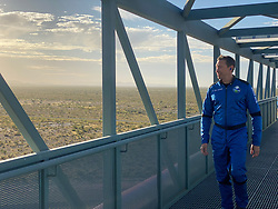 Handout photo dated October 13, 2021 of NS-18 astronaut Glen de Vries walks across the gantry. Hollywood actor William Shatner has become the oldest person to go to space as he blasted off aboard the Blue Origin sub-orbital capsule. The 90-year-old, who played Captain James T Kirk in the Star Trek films and TV series, took off from the Texas desert with three other individuals. Mr Shatner's trip on the rocket system - developed by Amazon.com founder Jeff Bezos - lasted about 10 minutes. Photo by Blue Origin via ABACAPRESS.COM