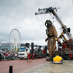 LIVERPOOL, UK, 20th April, 2012. The Sea Odyssey. The giant Uncle is lifted out of Salthouse Dock and walks around Liverpool in search of his niece.