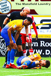 Jacob Mellis of Mansfield Town checks on an injured Tyler Walker of Mansfield Town - Mandatory by-line: Ryan Crockett/JMP - 27/04/2019 - FOOTBALL - One Call Stadium - Mansfield, England - Mansfield Town v Stevenage - Sky Bet League Two