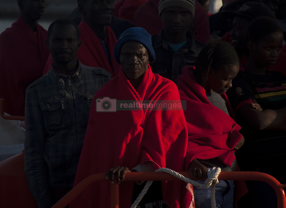 October 6, 2018 - Malaga, Spain - Migrants wait to disembark on a rescue boat after their arrival at the Port of Malaga. Spain's Maritime Rescue service rescued 200 migrants aboard dinghies at the Mediterranean Sea and brought them to Malaga Harbour, where they were assisted by the Spanish Red Cross. During this day, more than 400 migrants have been rescued by the Spain's Maritime Rescue. (Credit Image: © Jesus Merida/SOPA Images via ZUMA Wire)