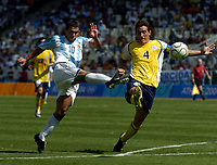 28/08/04 - ATHENS - GREECE -  - OLYMPIC FOOTBALL - FINAL MATCH - MENS  -  At the Olympic Stadium in Athens<br />ARGETNINA (1) win over PARAGUAY (0).<br />Argentine player N* 10 CARLOS TEVEZ great shoot and Paraguay N*4 CARLOS GAMARRA.<br />© Gabriel Piko / Argenpress.com / Piko-Press