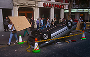 The clean-up begins the morning after the Poll Tax riot,  on 1st April 1990, in Charing Cross Road, London, England. Angry crowds, demonstrating against Margaret Thatchers local authority tax, stormed the Whitehall area and then Londons West End, setting fire to a construction site and cars, looting stores up Charing Cross Road and St Martins Lane. The anti-poll tax rally in central London erupted into the worst riots seen in the city for a century. Forty-five police officers were among the 113 people injured as well as 20 police horses. 340 people were arrested.