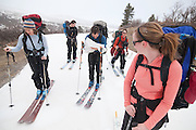 A group of backcountry skiers navigate towards the North Pole Hut in the Sneffels Range, San Juan Mountains, Colorado.